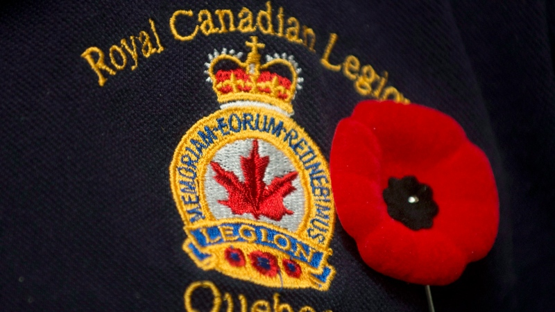 A poppy is pinned next to a Royal Canadian Legion crest in Montreal, November 2, 2012. THE CANADIAN PRESS/Graham Hughes.
