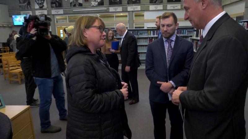 Darlene Bennett speaks to B.C. Public Safety Minister Mike Farnworth at a local school in Surrey on Dec. 5, 2019.