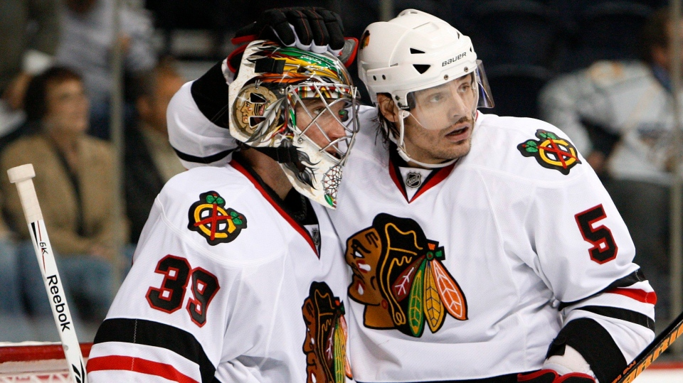 Chicago Blackhawks defenceman Brent Sopel (5) congratulates goalie Cristobal Huet (39), of France, after the Blackhawks beat the Nashville Predators 3-1 in an NHL hockey game in Nashville, Tenn., Thursday, Oct. 15, 2009. THE CANADIAN PRESS/AP/Mark Humphrey