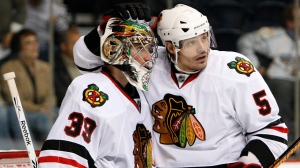 Chicago Blackhawks defenceman Brent Sopel (5) congratulates goalie Cristobal Huet (39), of France, after the Blackhawks beat the Nashville Predators 3-1 in an NHL hockey game in Nashville, Tenn., on Oct. 15, 2009. (THE CANADIAN PRESS / AP / Mark Humphrey)