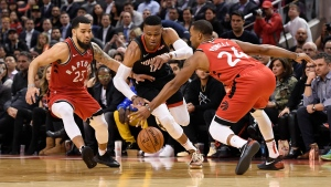 Houston Rockets guard Russell Westbrook (0) drives between Toronto Raptors guards Fred VanVleet (23) and Norman Powell (24) during second half NBA action in Toronto on Thursday, Dec.5, 2019. THE CANADIAN PRESS/Nathan Denette