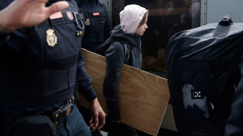 Climate activist Greta Thunberg arrives in Madrid on Friday Dec. 6, 2019. (AP Photo/Andrea Comas)