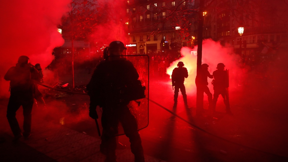 Riot police officers secure an area during a demonstration in Paris, Thursday, Dec. 5, 2019. (AP Photo/Thibault Camus)