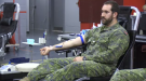 Soldiers roll up their sleeves and give blood