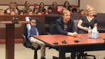 Five-year-old Michael's entire kindergarten class sat in the audience behind him waving big red hearts mounted on wooden sticks to show their support. (source: Kent County, MI via CNN)