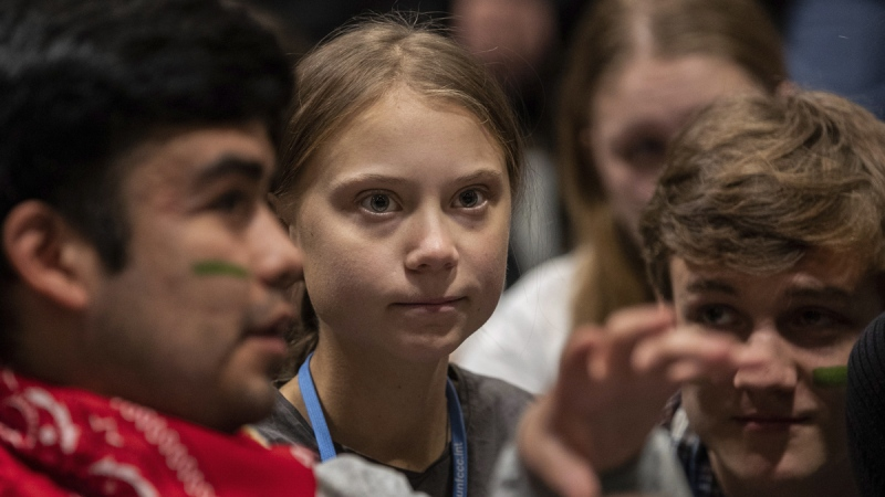 Climate activist Greta Thunberg, centre, at the COP25 climate talks summit in Madrid, on Dec. 6, 2019. (Bernat Armangue / AP)