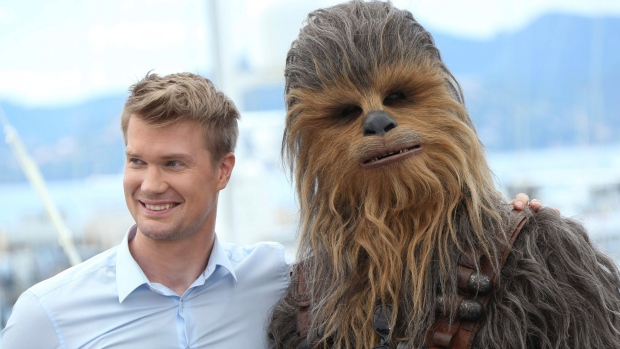 "In this May 15, 2018 file photo, Finnish actor Joonas Suotamo, left, poses with a person wearing a Chewbacca costume during a photo call for the film ""Solo: A Star Wars Story'""at the 71st international film festival, Cannes, southern France. (Joel C Ryan/Invision/AP, File)"