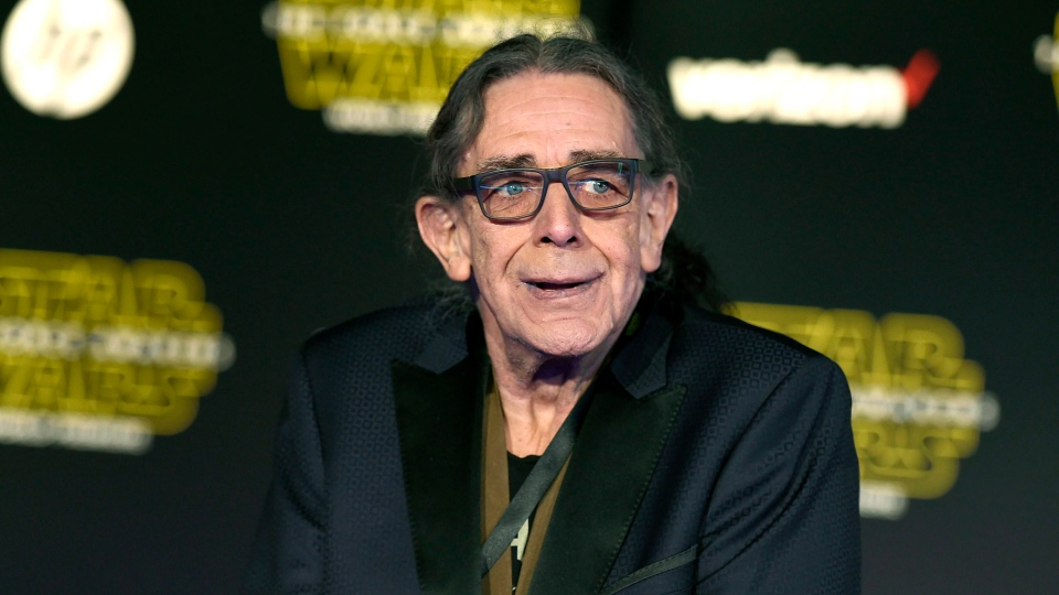 In this Dec. 14, 2015, file photo, Peter Mayhew arrives at the world premiere of