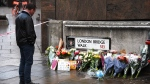 Flowers and a pictures are left in memory of Jack Merritt, who is the first victim to be named following Friday's terror attack on London Bridge in London, Sunday, Dec. 1, 2019. (AP Photo/Alberto Pezzali)