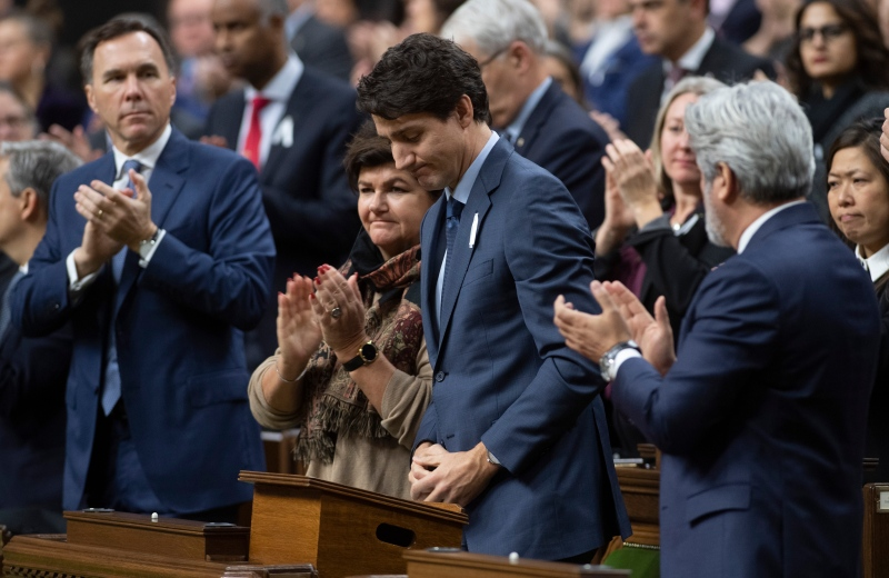 Prime Minister Justin Trudeau is applauded after rising in the House of Commons on the anniversary of the 1989 Ecole Polytechnique Montreal tragedy Friday December 6, 2019 in Ottawa. THE CANADIAN PRESS/Adrian Wyld