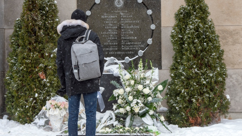 Former student Richard Gregoire stands at the school's memorial to mark the 30th anniversary of the 1989 Ecole Polytechnique attack where a lone gunman killed 14 female students Friday, December 6, 2019 in Montreal.THE CANADIAN PRESS/Ryan Remiorz