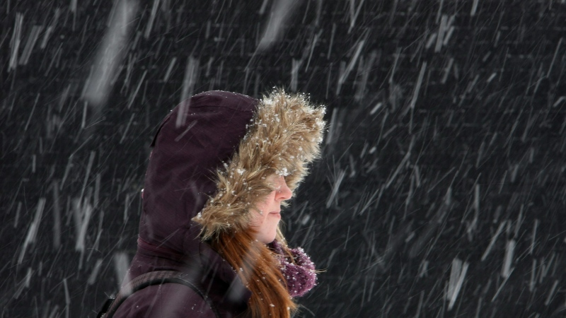 In this file image, student Alex Poetschke stands in the heavy snow at the University of Western in London, Ont., Wednesday, February 2, 2011. (THE CANADIAN PRESS/Dave Chidley)