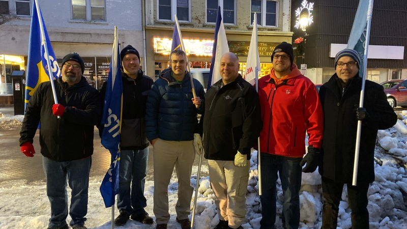 District 4 leaders of OSSTF, OECTA, and ETFO standing together on the eve of the OSSTF Wednesday walkout Dec. 4, 2019. (Twitter/ @District4TBU)