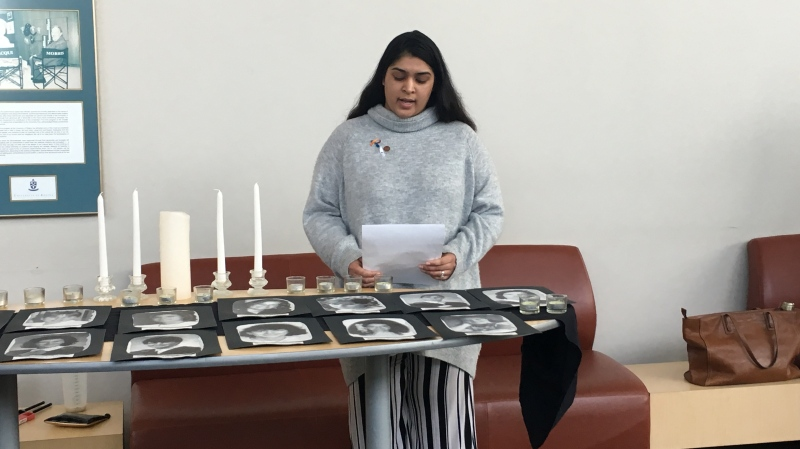 A student speaks at a 30th anniversary ceremony for the École Polytechnique massacre at the University of Regina.