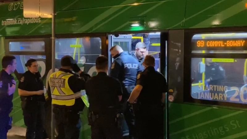 Vancouver police and transit security surround a 99 B-Line bus in Vancouver while a violent passenger was being arrested. (Edison Wrzosek image)