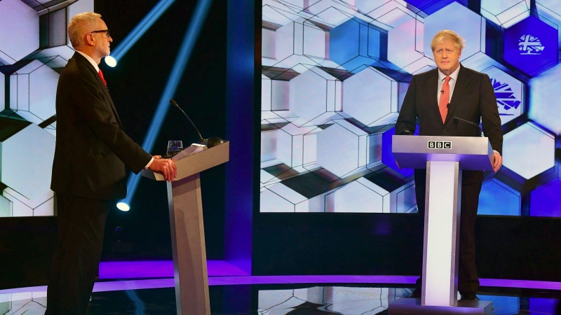 Opposition Labour Party leader Jeremy Corbyn, left, and Britain's Prime Minister Boris Johnson, during a head to head live Election Debate at the BBC TV studios in Maidstone, England, Friday Dec. 6, 2019. Britain's Brexit is one of the main issues for political parties and for voters, as the UK prepares for a General Election on Dec. 12. (Jeff Overs/BBC via AP)