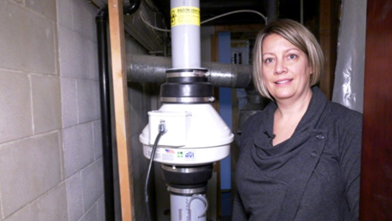 Marci Tyc and the radon mitigation system she had installed in November. (Source: Michelle Gerwing/ CTV News Winnipeg)