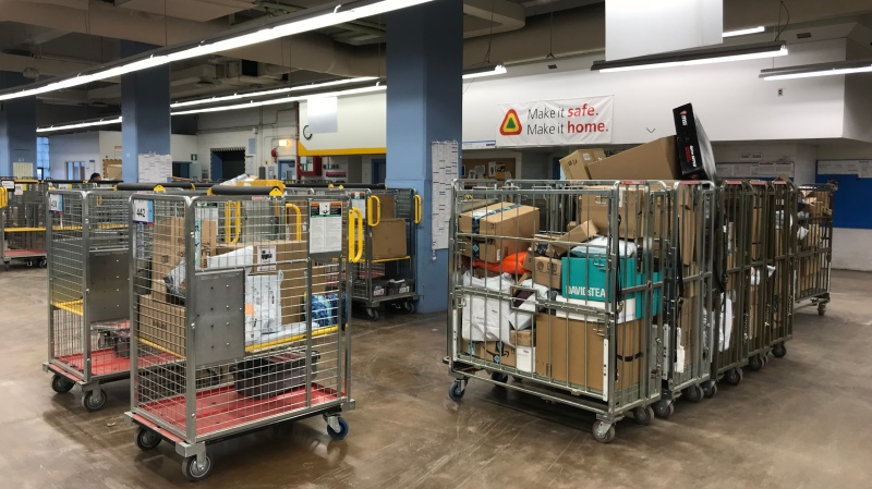 Several packages are seen in Regina's Canada Post office. (Kayleen Sawatzky/CTV News)