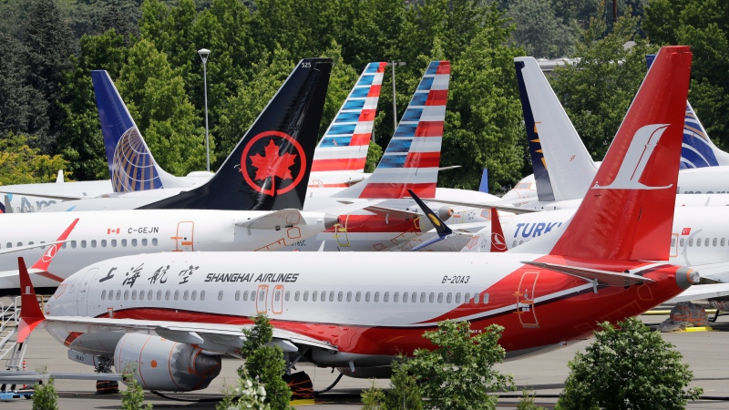 In this Thursday, June 27, 2019 file photo, dozens of grounded Boeing 737 MAX airplanes crowd a parking area adjacent to Boeing Field in Seattle. Safety regulators want to fine Boeing nearly $4 million, saying that the company installed critical wing parts on 133 planes even though it knew the parts were faulty. The Federal Aviation Administration announced the proposed civil penalty on Friday, Dec. 6, 2019. (AP Photo/Elaine Thompson, File)