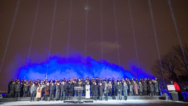 Fourteeen beams of light point skyward during ceremonies to mark the 30th anniversary of the 1989 Ecole Polytechnique attack where a lone gunman killed 14 female students, Friday, December 6, 2019 in Montreal.THE CANADIAN PRESS/Ryan Remiorz