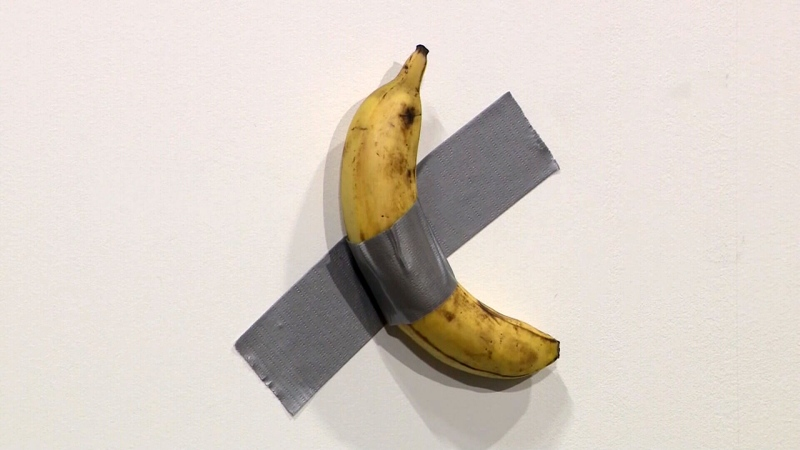 "This is an art piece by Maurizio Cattelan, titled ""Comedian"" -- and it's literally just a banana duct-taped to a wall. It also has already sold for $120,000."
