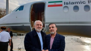 In this photo released on twitter account of Iran's Foreign Minister Mohammad Javad Zarif , Zarif, left, shakes hand with Iranian scientist Massoud Soleimani prior to leaving Zurich, Switzerland for Tehran, Iran, Saturday, Dec. 7, 2019. (Javad Zarif twitter account via AP)