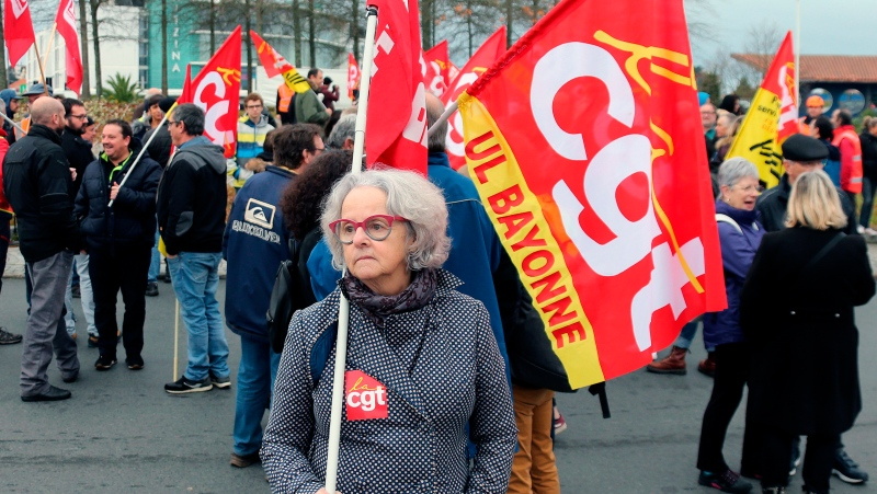 Trade union demonstrators protest in Anglet southwestern France, Saturday Dec. 7, 2019. (AP Photo/Bob Edme)