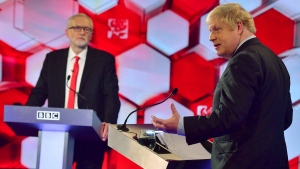 Opposition Labour Party leader Jeremy Corbyn, left, and Britain's Prime Minister Boris Johnson, during a head to head live Election Debate at the BBC TV studios in Maidstone, England, Friday Dec. 6, 2019. (Jeff Overs/BBC via AP)
