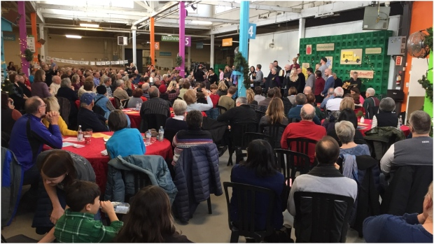 "Audience members watch a special production of the musical ""Come From Away"" at the Daily Bread Food Bank Saturday. (CTV News Toronto/Beth Macdonell)"