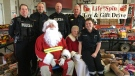 London police, EMS and fire officials pose with Santa Claus on Dec. 7, 2019. (Brent Lale/CTV London)