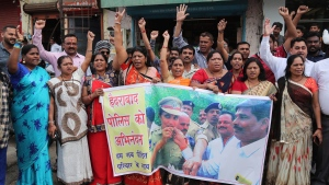 Indians shout slogans in favor of police to celebrate killing of four men suspected of raping and killing a woman in Shadnagar in southern state of Telangana, in Ahmadabad, India, Friday, Dec. 6, 2019. (AP Photo/Ajit Solanki)