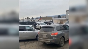 Video shows a white SUV careening through a Kamloops parking lot, scraping many of the cars and emerging with a torn-off bumper.