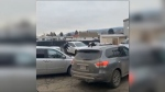 Video shows a white SUV careening through a Kamloops parking lot, scraping many of the cars and emerging with a torn-off bumper. (Travis Jabs / Facebook)