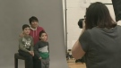 Volunteers take free family portraits