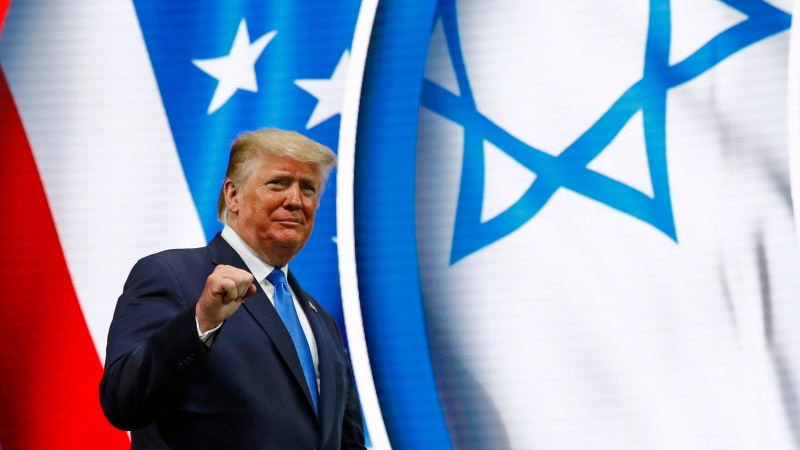 U.S. President Donald Trump walks onstage to speak at the Israeli American Council National Summit in Hollywood, Fla., Saturday, Dec. 7, 2019. (AP Photo/Patrick Semansky)