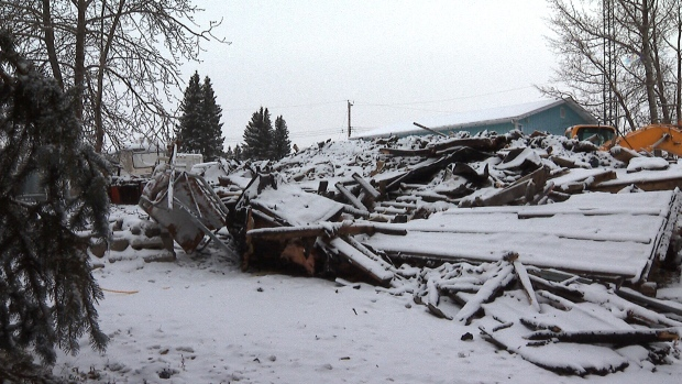 The wreckage of a house fire that took the lives of three children and their grandparents in Rochfort Bridge, Alta. is seen here on Saturday, Dec. 7, 2019.