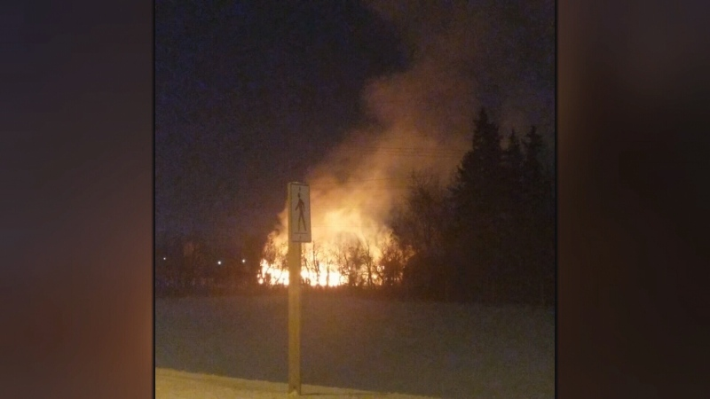 The flames of a barn fire near 153 Street on Dec. 7, 2019, was visible from Mark Messier Trail.