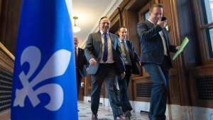 Quebec Premier Francois Legault, centre, finished a stormy parliamentary session, Saturday December 7, 2019 in Quebec City, and will now head to California to talk about the Carbon Exchange. THE CANADIAN PRESS/Jacques Boissinot