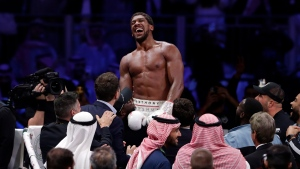 Anthony Joshua celebrates after beating Andy Ruiz Jr. to win their World Heavyweight Championship contest at the Diriyah Arena, Riyadh, Saudi Arabia. (AP Photo/Hassan Ammar)