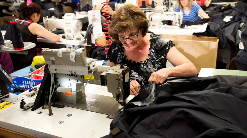Employees work with Canada Goose jackets at the Canada Goose factory in Toronto on Thursday, April 2, 2015. (THE CANADIAN PRESS / Nathan Denette)