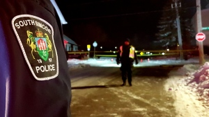 South Simcoe Police officers reconstruct the scene where a 'fail to remain' collision left a 67-year-old man with critical injuries Saturday December 7th. (Photo: South Simcoe Police)