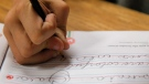 A student practices writing in cursive at St. Mark's Lutheran School in Hacienda Heights, Calif., Thursday, Oct. 18, 2012. (AP Photo/Jae C. Hong)
