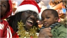 Allister Thomas performs as Black Santa in East York on Saturday. (CTV News Toronto/Corey Baird)