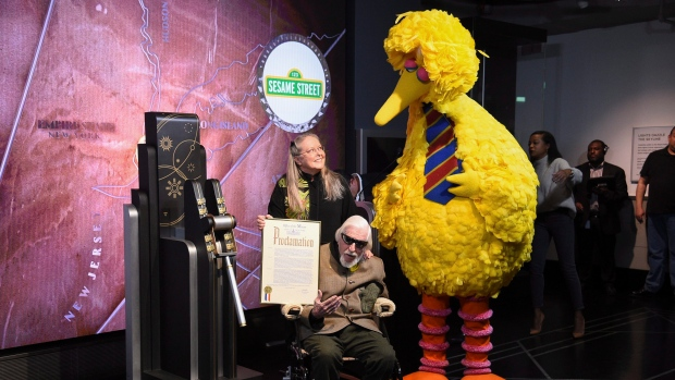 Sesame Street's Big Bird and puppeteer Caroll Spinney participate in the ceremonial lighting of the Empire State Building in honor of Sesame Street's 50th anniversary on Friday, Nov. 8, 2019, in New York. (Photo by Evan Agostini/Invision/AP)