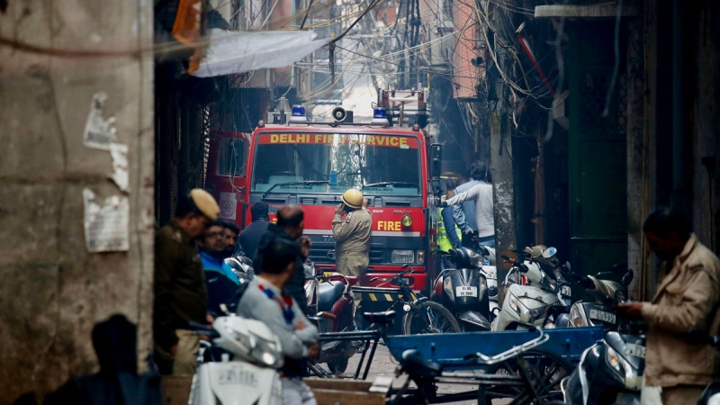 A fire engine stands by the site of a fire in a narrow lane in New Delhi, India, Sunday, Dec. 8, 2019. A doctor at a government-run hospital says dozens have died in a major fire in central New Delhi. (AP Photo/Manish Swarup)