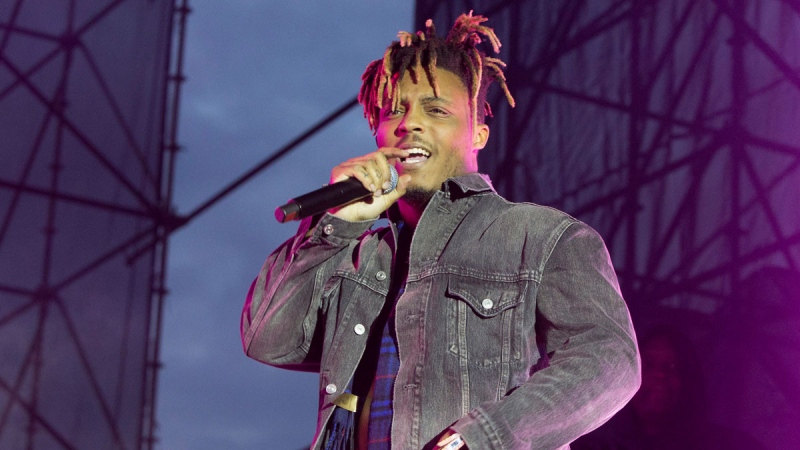 FILE - In this May 15, 2019 file photo, Juice WRLD performs in concert during his 'Death Race for Love Tour' at The Skyline Stage at The Mann Center for the Performing Arts in Philadelphia. (Photo by Owen Sweeney/Invision/AP, File)