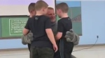 Dad deployed in U.S. army surprises three sons