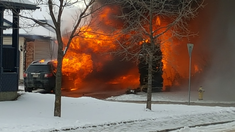 Area resident Matthew Stephen took photos of the blaze showing flames coming from the house as well as a vehicle. (Courtesy: Matthew Stephen)