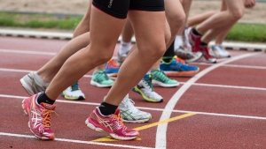 People running in marathon (Pexels)