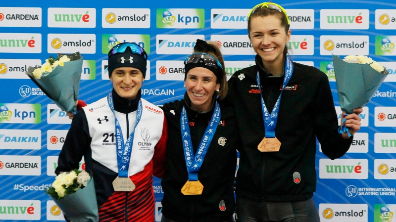 From Left: Martina Sablikova of Czech Republic, second place, Ivanie Blondin of Canada, first place, and Isabelle Weidemann of Canada third place stand on the podium after the ladies 5000 meters race of the speed skating World Cup at the Alau Ice Palace in Nur-Sultan, Kazakhstan, Friday, Dec. 6, 2019. (AP Photo/Stas Filippov)